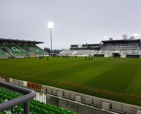 Final football pitch check-up before the international friendly match