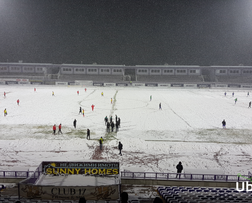 Clearing the pitch from the snow